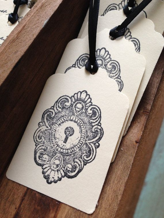 Handmade tags stamped with a vintage key hole cover. Perfect for lock and key wedding!