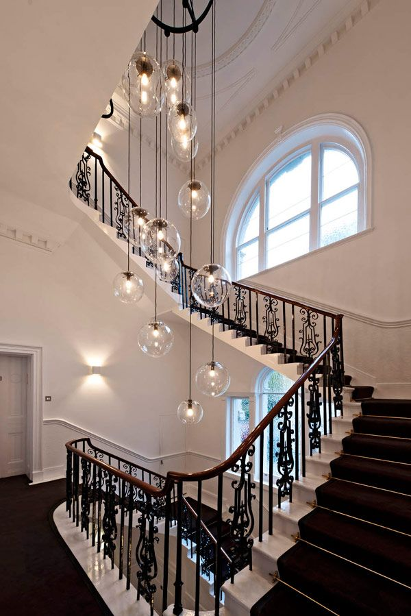 light globes and wrought iron staircase