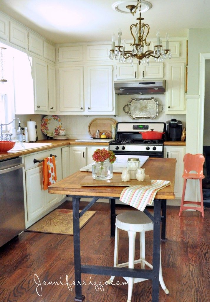 inspired kitchen with rustic elements. Great idea using a vintage workbench as an island.