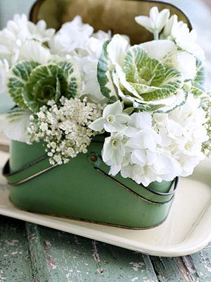Vintage lunch box with hydrangeas, viburnum, paperwhites. and kale