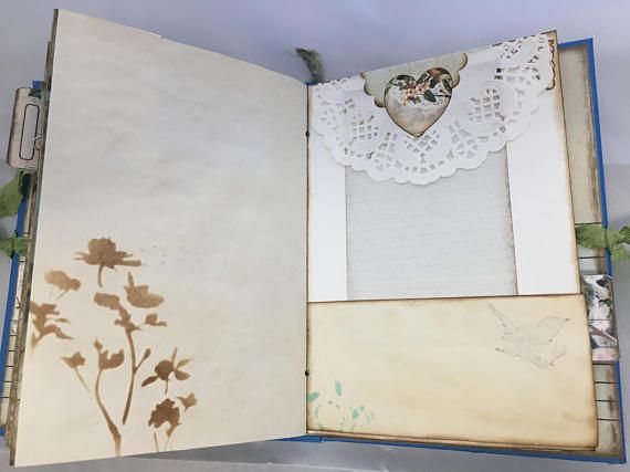 This romantic style junk journal was created using the MAJESTIC BIRDS Designs by ARTYmaze.  The journal features a Wonderful Victorian Vintage theme. It is approximately 6 1/2 x 4 1/2 inches and has a little over a 1 inch spine. Bound using the twine and eyelets. Its two signatures has 48 full pages for journaling. Inside additonally there are large pocket pages and smaller pages inside for additonal journaling. There is stamping, tea stained paper, vintage book pages, banners, bell...