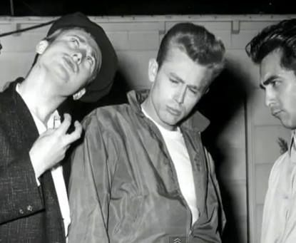 A behind the scenes shot of actors Nick Adams, James Dean and Perry Lopez mimicking Marlon Brando during filming of the classic 1955 drama, REBEL WITHOUT A CAUSE!