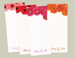"""Who doesn't love flowers?   Adorn a gift with gerber daisies...  Really impress with a written note on roses...  Send newlyweds a floral lucite tray...  Send someone the gift of flowers on folded greetings that will live all year long...    Each """"pack-of-pads"""" includes 4 (30 sheet) note pads, all of assorted colors and are of course, PERSONALIZED.  You might have one for grocery lists & notes in kids' lunches, by the phone for messages, on your desk for """"honey do"""" lists, love notes & more..."""