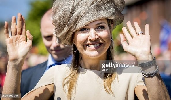Dutch Queen Maxima salutes the crowd during the start of Neighbours' Day in Urk, Flevoland province, on June 9, 2016. During Neighbours' Day residents organize activities that promotes contact...