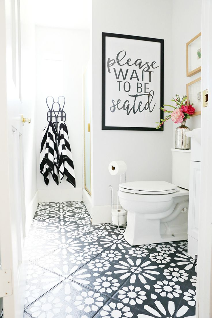 This painted stencil bathroom floor project totally changed the look of the room. It was a lot cheaper than re-tiling the floor, too.