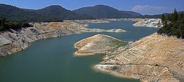 Lake Oroville... After years of a continuous throughout California, the levels of Lake Oroville have been at record breaking lows. Lake Oroville is a reservoir in the U.S. state of California, formed by the Oroville Dam across the Feather River. The lake is situated in the foothills of the Sierra Nevada just northeast of the City of Oroville. It is one of the largest reservoirs in California, after Shasta Lake. The lake is fed by the North Fork, Middle Fork, West Branch and South Forks of…