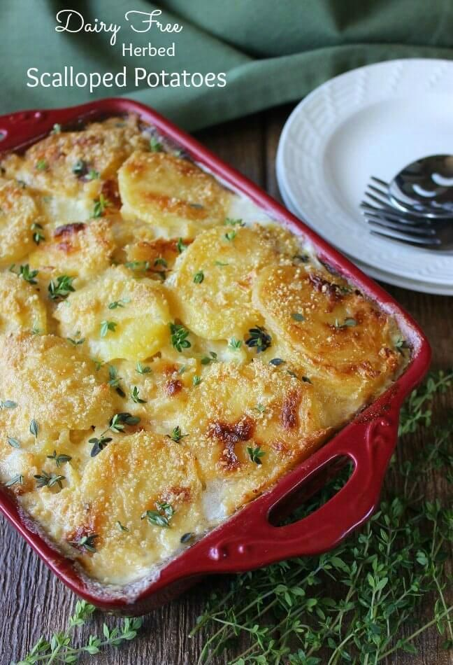 Dairy Free Herbed Scalloped Potatoes is comfort food at it's best.  Potatoes baked in a casserole that have been covered with a creamy white sauce.  Herbs sprinkled over all for a little extra sumpin sumpin.: