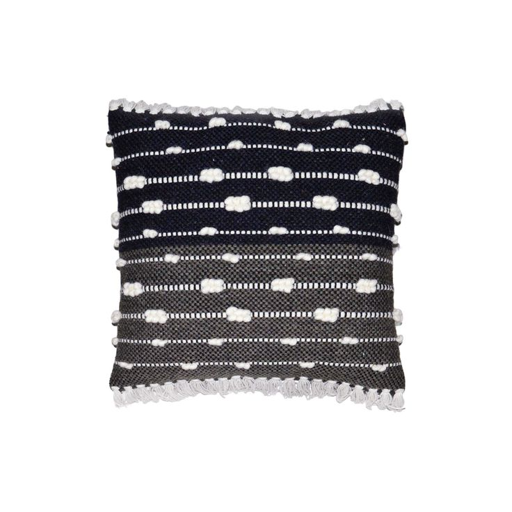 """This graphic throw pillow uses a black base and white stripes with tufting for maximum appeal. The Black Throw Pillow with White Stripes (18"""") from Threshold even incorporates a narrow fringe along the edges for a finishing touch."""