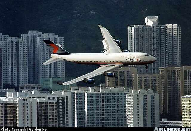 A long since dead Canadian Airline on approach into Hong Kong's old Kai Tak airport...