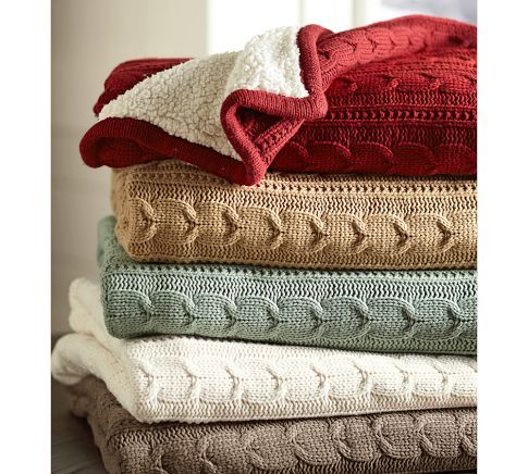 My favorite blanket in my home. I wish it was bigger! I have it in the creme color.  Cozy Cable-Knit Throw | Pottery Barn