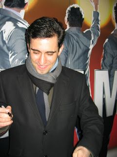 JLY signing autographs