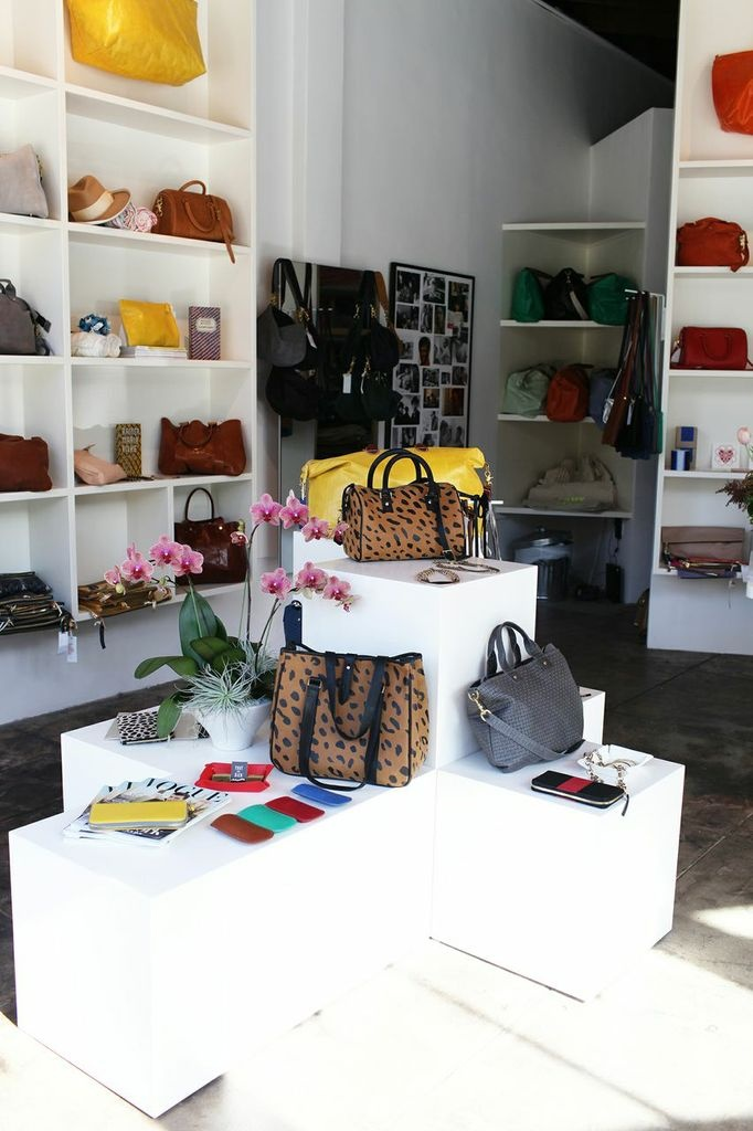 Fashion Designer @Clare Vivier // store display // handbags // leopard // yellow // black // photography by @Kimberly Genevieve