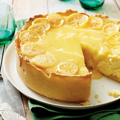 Lemon Bar Cheesecake   This indulgent recipe marries two delicious desserts: lemon bars and cheesecake. Using a dark springform pan ensures a golden brown crust on this tart dessert recipe without having to bake before adding the filling.