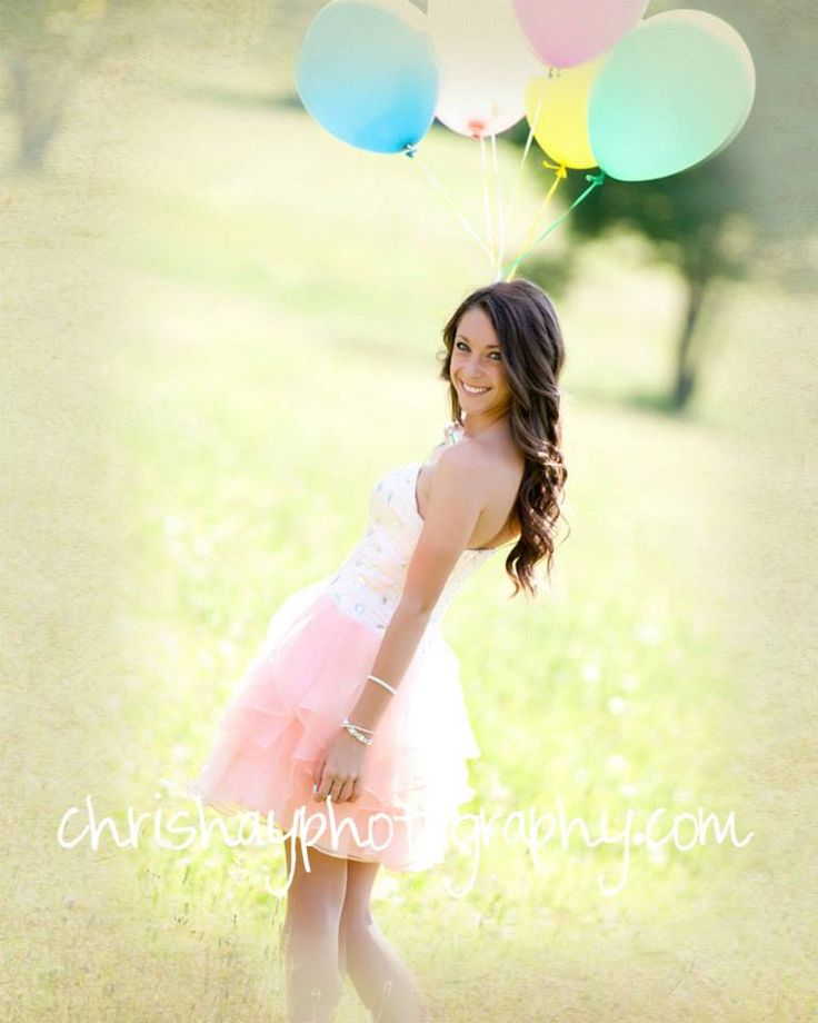Senior Pictures done by Chris Hay Photography.  Had some fun with these balloons in a formal dress with cowboy boots in a field :)
