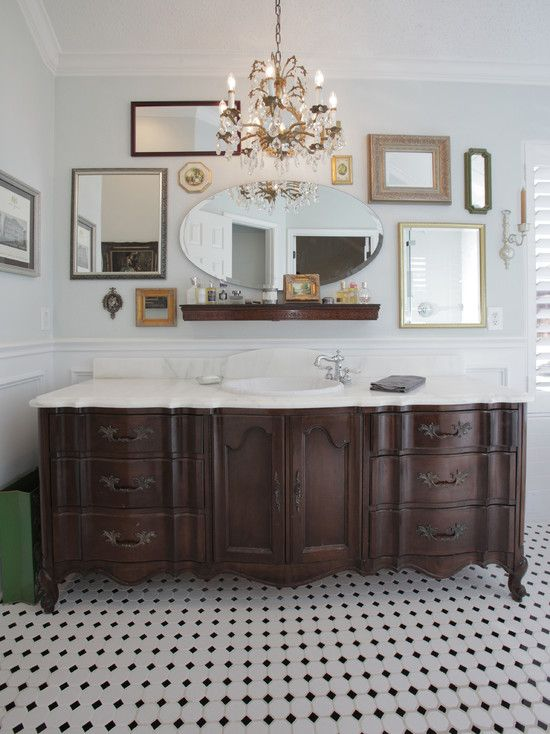 Vintage Style Bathroom A Repurposed Dresser Crystal Chandelier And Mismatched Wall Mirrors Work Together To Create One Of
