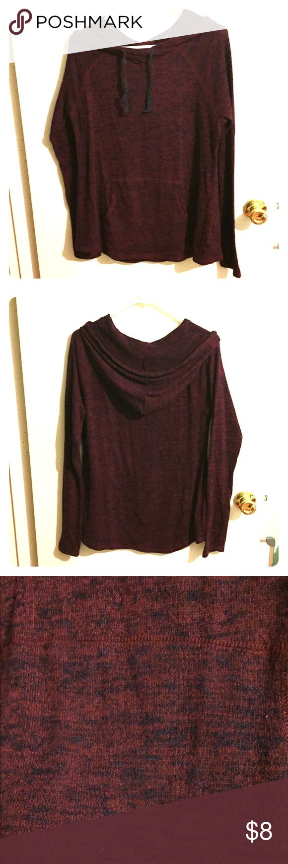 Long sleeve, hooded pullover Here's a burgundy/maroon and navy long sleeve top with a hood and pocket in the front! Worn quite a bit, but still in good condition. BUNDLE TO SAVE. I have numerous gorgeous sweaters. Kirra Tops Tees - Long Sleeve