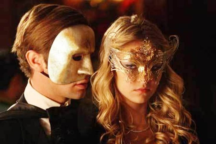 A Couple Wearing  Masquerade Mask