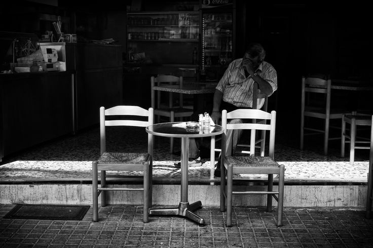 This place serves Greek souvlaki and it is just a couple of blocks away from my home. I walk past it every day on my way to my daughter's school. It is owned by a man and a woman in their late 50s. The day I took this shot the man was alone in his Souvlaki place and was taking a nap on one of the chairs. I snapped him instinctively. Snap!