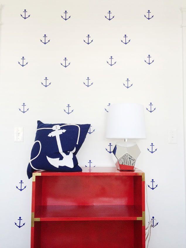 Nautical vinyl appliques on Benjamin Moore Decorator White with red campaign shelving. www.pencilshavingsstudio.com