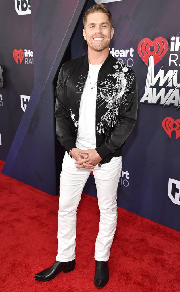 "Dustin Lynch from 2018 iHeartRadio Music Awards Red Carpet Fashion - The ""Small Town Boy"" singer brings some country to Los Angeles."