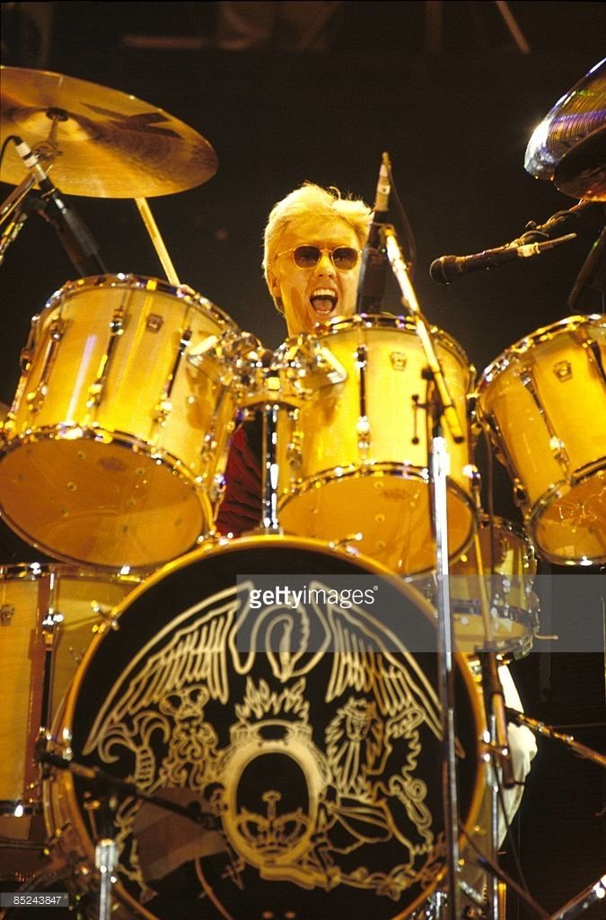 STADIUM Photo of QUEEN and Roger TAYLOR, Drummer with Queen performing on stage at th Freddie Mercury Tribute concert