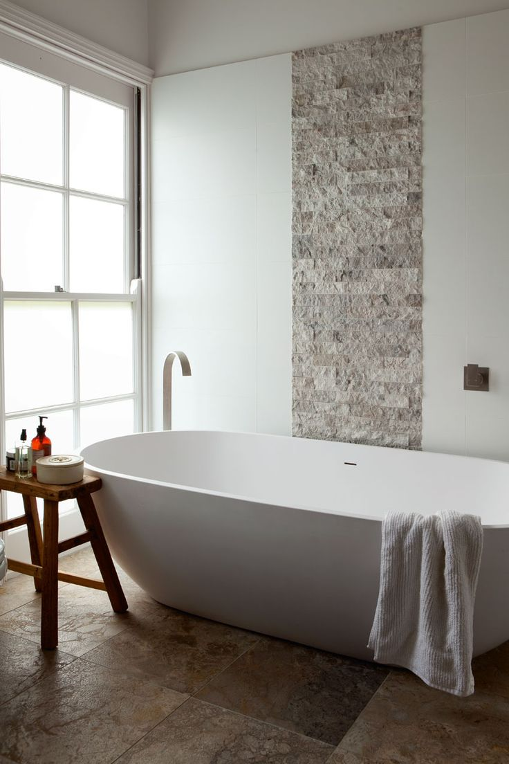 This gorgeous 70s era home has been given a style revival bathroom feature wallfeature