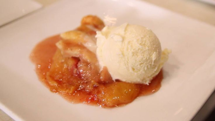 What's more American than peach cobbler? Peach cobbler with bourbon, of course! Kevin Roth stops by Chino Chinatown to visit Chef Uno Immanivong. While he's there she whips up a batch o…