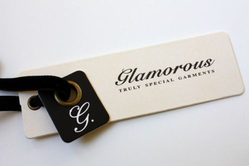 small tag with logo + bigger sized swing tag with more details