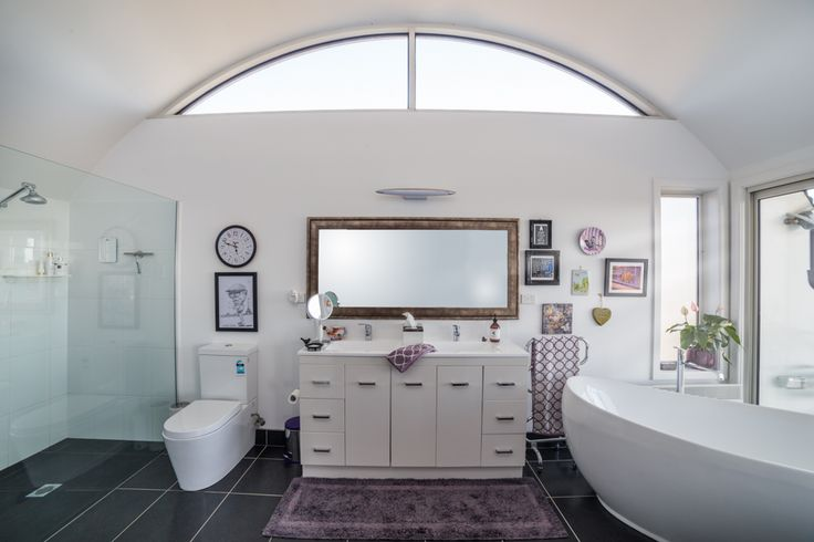 Convertible House: This amazing ensuite extends from  a generous master bedroom. The curved ceilings add to the feeling of serenity of this space