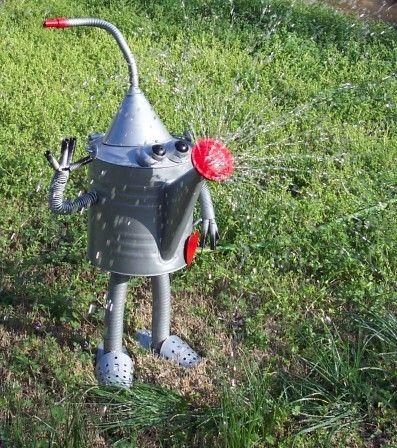 recycled metal watering tin man