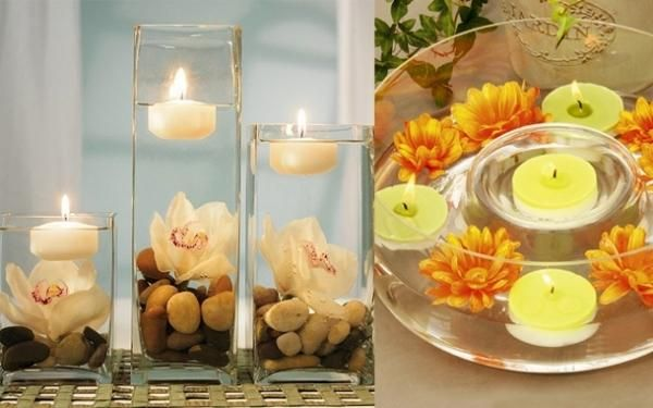 candles, water, flowers, stones in glass vases