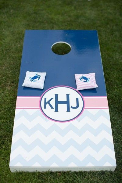 Everyone loves a little wedding #cornhole - great way to entertain guests! {Natalie Franke Photography}