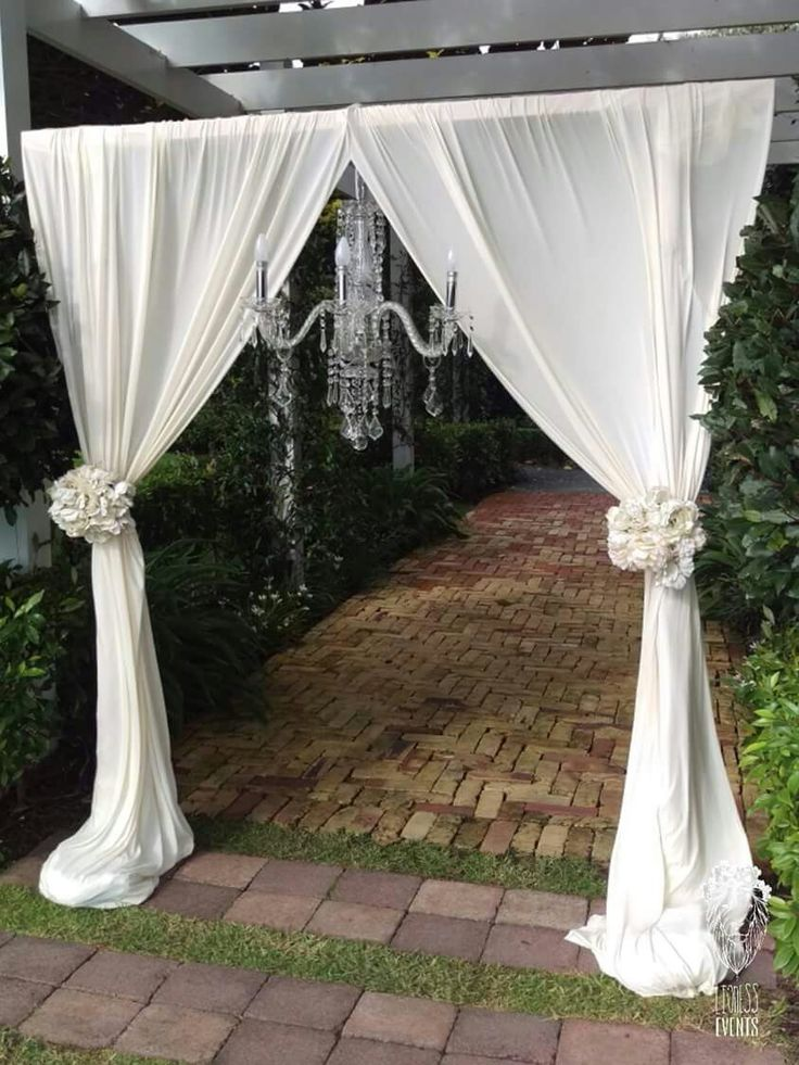 THE ROYAL DRAPE WEDDING ARCH WITH CHANDELIER LIONESS CREATIVE EVENTS www.facebook.com/lionesscreativeevents