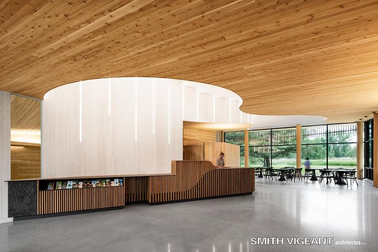 Wood interior Design Smith Vigeant Architectes Welcome center Light well