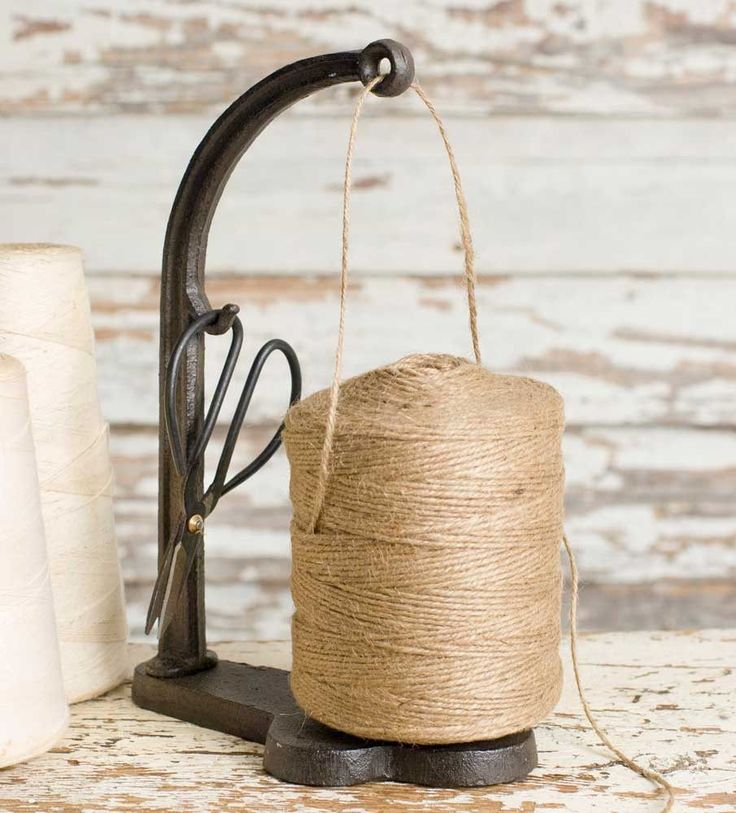 """This cast iron piece includes jute, scissors, and the stand. 4""""W x 6½"""" x 10""""T."""