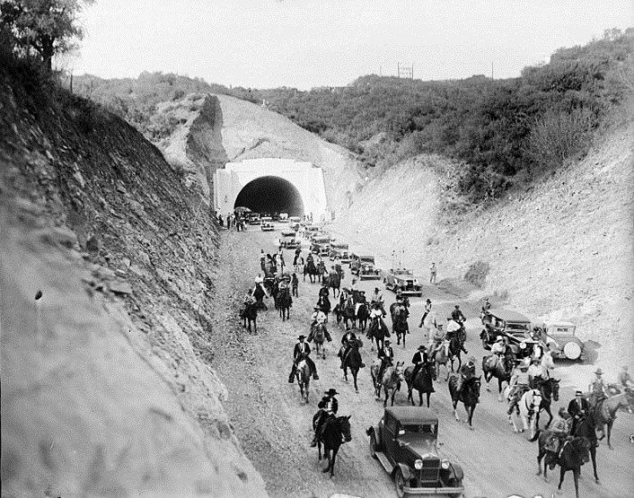 (1930)^^ - View of a procession of cars, horses and wagons moving south through the new Sepulveda Boulevard tunnel following opening ceremonies. After eight years of road construction, the new tunnel connected the San Fernando Valley with West Los Angeles.