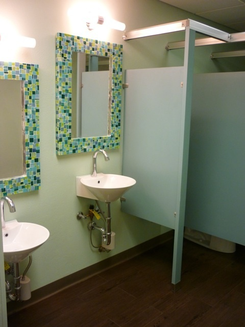 Simple bathroom renovation with framed mirrors simple but for Church bathroom designs