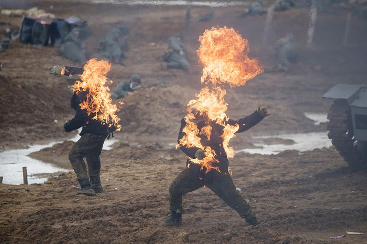 Members of historic clubs wearing historic Nazi German uniforms take part in a staged battle during a reconstruction of the Berlin offensive operation, in Kubinka outside Moscow, Russia, on April 23, 2017.