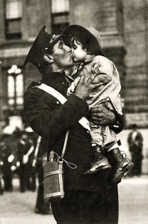 A Canadian soldier kisses his daughter goodbye before going off to war.  Quebec.  1914.
