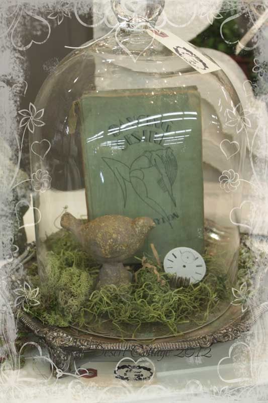 I love the bird and book inside this cloche!