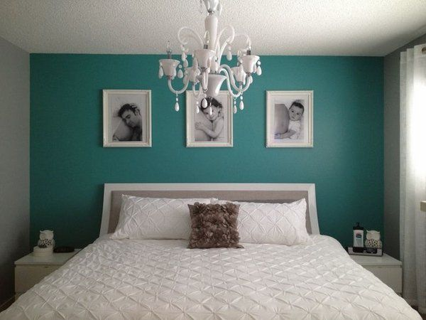 teal bedroom wall color balanced with white furniture bedding set and chandelier