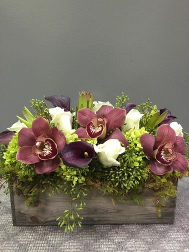 Vintage Beauty is a festive mix of orchids, calla lilies, protea, roses and greens that is the perfect #Thanksgiving centerpiece.