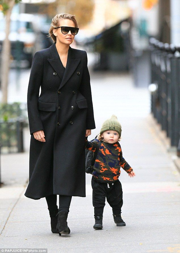 Doting: Lara Worthington (nee Bingle), 29, was spotted enjoying a walk with her firstborn Rocket Zot, one, in New York on Thursday, covering her post-pregnancy body in a chic black coat