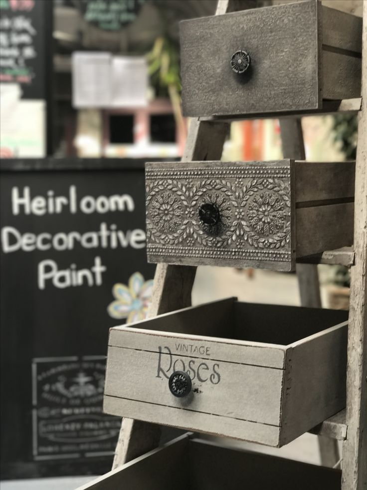 Textured paint effects using Heirloom Decorative Paint on drawer and ladder shelves.