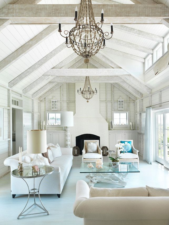 Nantucket Beach Cottage with Coastal Interiors in white, cream, bleached wood, and pops of color