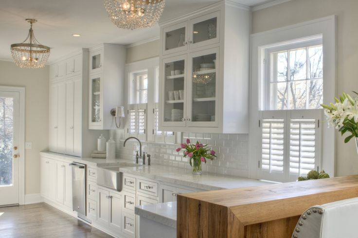 marble/subway tile combo, hardware, farmhouse sink, larger pantry cabinets in the back, glass cabinets