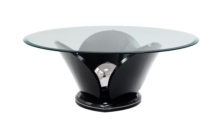 Tulip is a round coffee table, whose base is reminiscent of the blossom of a tulip.