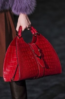 Gucci:  I'm convinced my daughter will love all my Gucci bags when she goes off to college.   By then, they'll be vintage.  What is better than vintage Gucci?