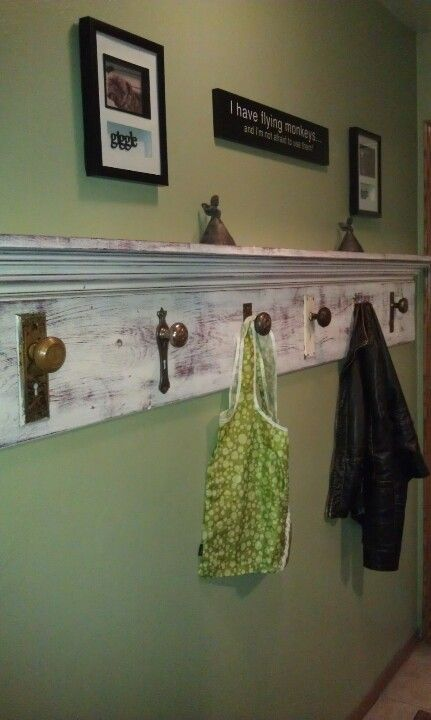 No mudroom?  No problem. - I collected antique door knobs and added them onto a leftover board for a great coat rack that can even stand up to winter parkas! Topping it off with salvaged crown moulding, created a great shelf for gloves and hats.
