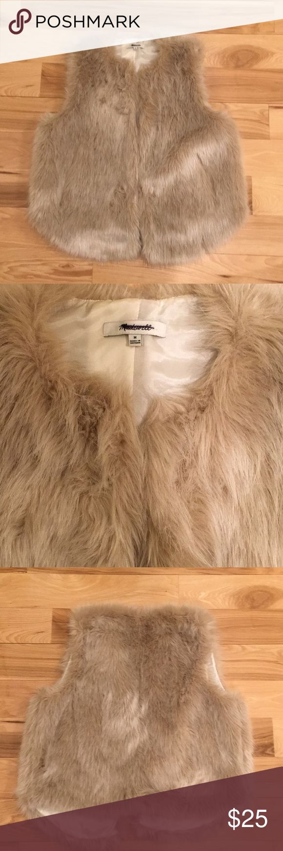 """🔥Madewell Faux Fur Vest sz M🔥 Cute faux fur vest from Madewell in size M. Pretty cream color. Collarless, fur clips for closure, and pockets! Approximately 23"""" long. There are some tiny pin dots on the lining where it was pinned to a display, but it does not effect the outward  appearance of the vest. I tried to show this in the last picture. Madewell Jackets & Coats Vests"""